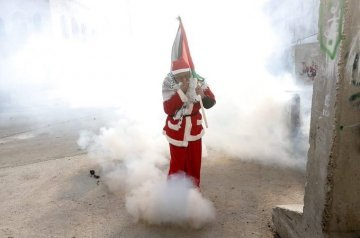 Santa being Teargassed by Israeli forces in Palestine