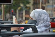 Muslim woman using her iphone
